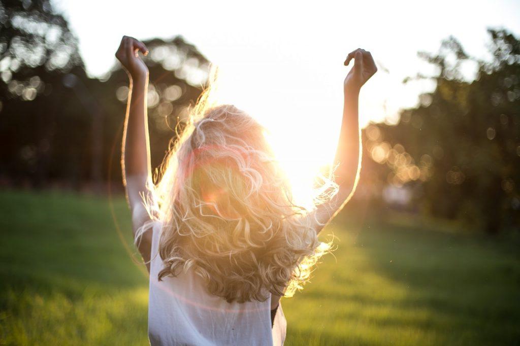Girl in front of sunlight
